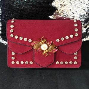 Suede handbag with beetle accent